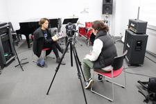 音楽科の非常勤講師である山岡 隼人(ハイト) 氏が地域生活情報&テレビ鳴門番組情報誌「リビング鳴門」の取材を受けました